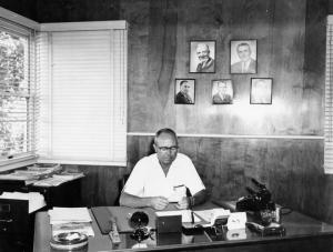 L. Wilsey at desk