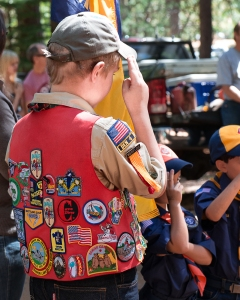 Cub Scout with lots of patches